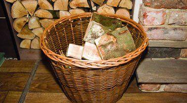 Logs in a wicker basket