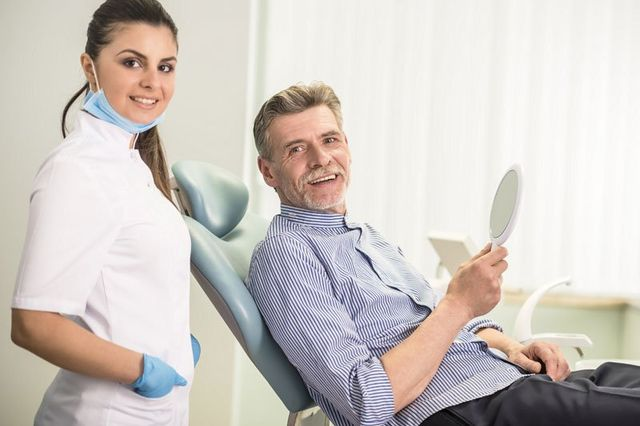 Female dentist with his patient in dental clinic