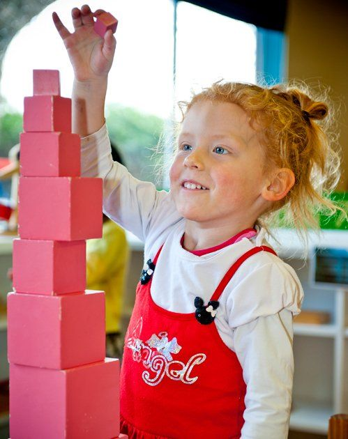 Little girl building blocks