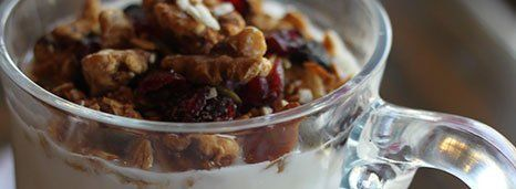 Yogurt parfait with seasonal fruit and granola