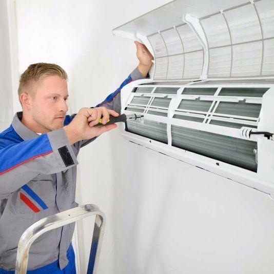 hvac service man working on air conditioner