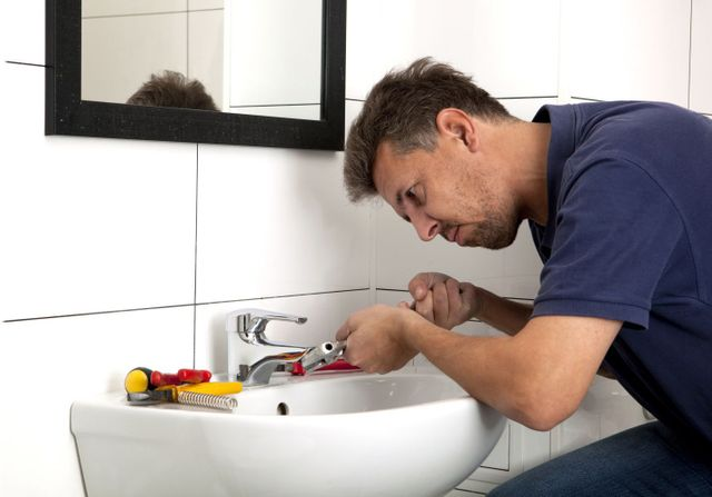 Expert in plumbing solutions reparing a bathroom sink in Paragould, AR
