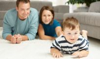 Family enjoying purchase made possible by low carpet prices in Gore