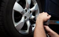 car rim being tightened during car repair service in Anchorage, AK