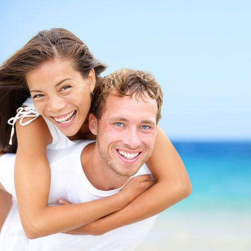 Smiling couple with great teeth