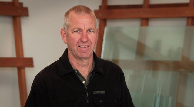 Man calling the experts for glass and window repairs in Christchurch