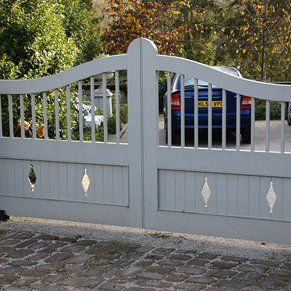 Large white double gates with diamond cut outs