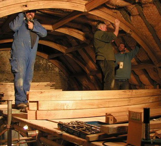 AR Manley team restoring wooden structure