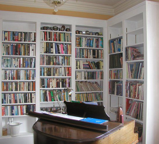 White wooden fitted bookcase
