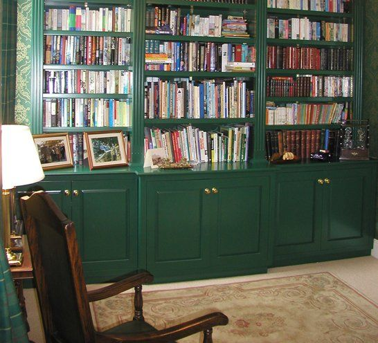 Fitted green shelves with cupboards
