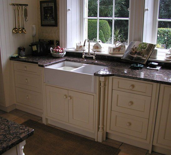 Fitted cream kitchen with large sink