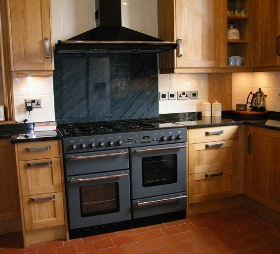 Wooden kitchen with large black oven