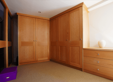 Fitted wooden wardrobe and drawers