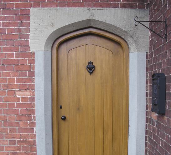 Wooden door with black metal knocker