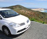 car driving alongside the coast