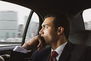 A business man looking out of a cab window