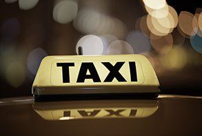 An illuminated taxi sign