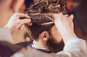 Professional barber styling hair cut