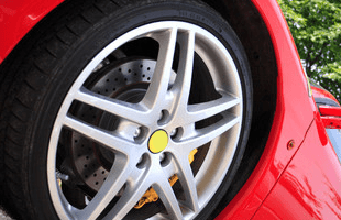 An alloy wheel on a red car