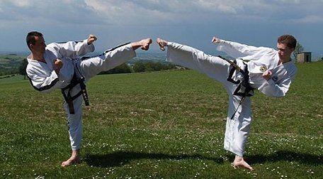 Two men train in Taekwon-Do