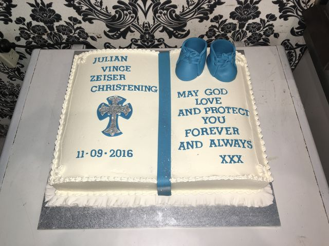 white christening cake book with blue details