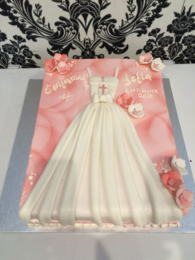 pink marble confirmation cake with white dress