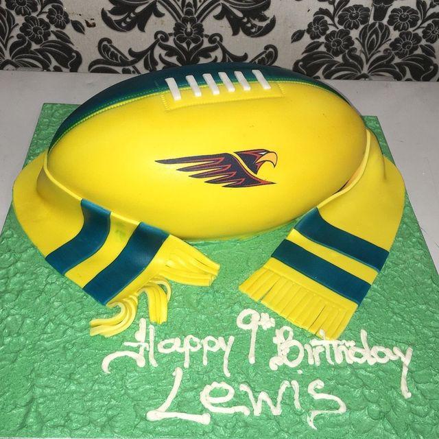 custom yellow football cake with scarf