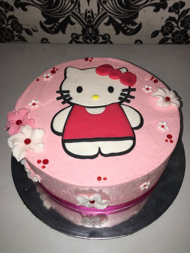 pink flowered custom hello kitty cake