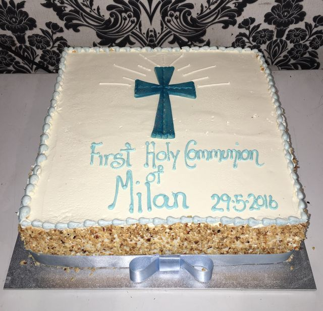white holy communion cake with blue cross