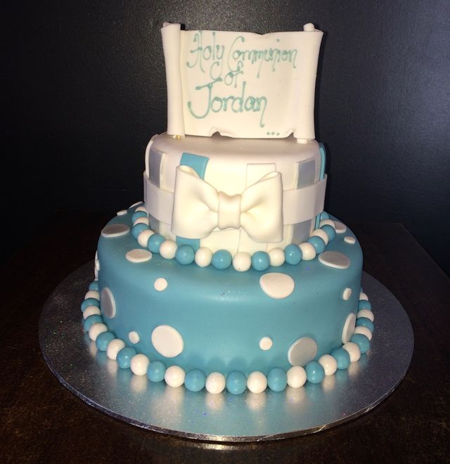 white holy communion cake with silver cross