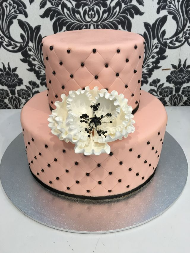 pink pillow effect double cake with black detail
