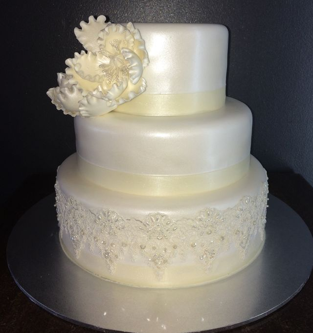 white triple layer cake with white fondent