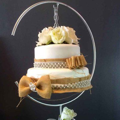Wedding cake with flowers suspended in metal ring