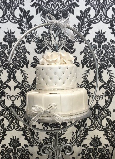 white panel cake below with white pillow top on top