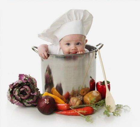 a small kid dressed like a chef