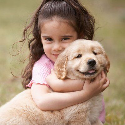 a girl holding the dog