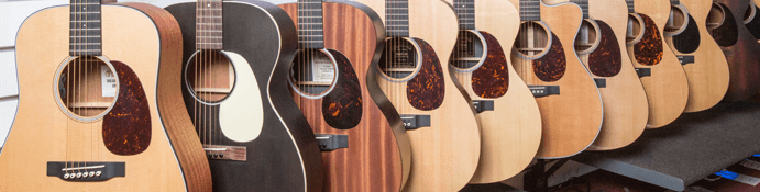 Range of acoustic guitars lined up