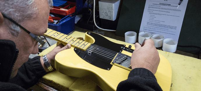 Man repairing guitar