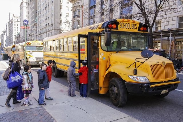 children getting on a school bus in NYC