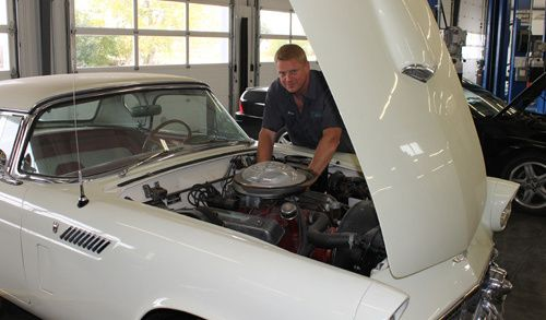 Man performing transmission repair in Lincoln, NE