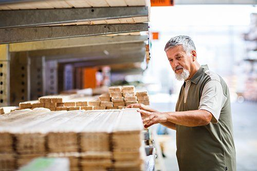 Customer choosing the right wood for furniture building