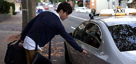 A man taking a taxi