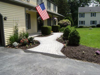 Landscaping with American Flag — Landscaping in East Syracuse, NY - Complete Landscaping Services - East Syracuse, NY - Turf Tamerz