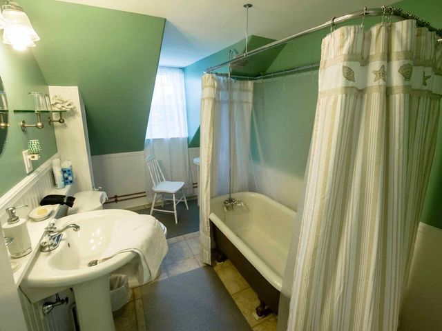 Abbe Suite bathroom with claw foot soaker tub