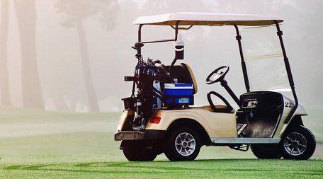 driverless golf buggy parked on grass