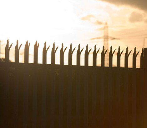 Security fence with spikes surrounding an business property