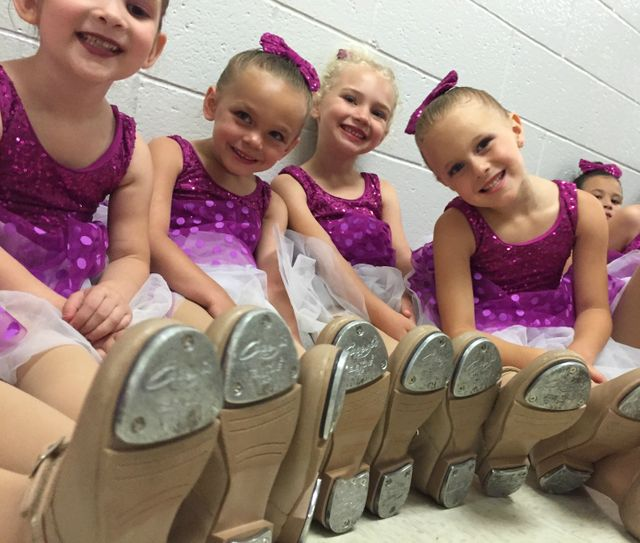 Four Smiling Tap Dancers