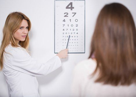 Experienced optometrist testing the eyes
