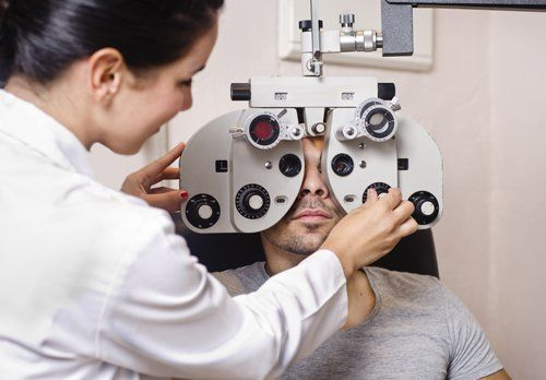 Optometrist examining the eye