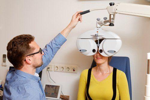 Professional optometrist testing the eye